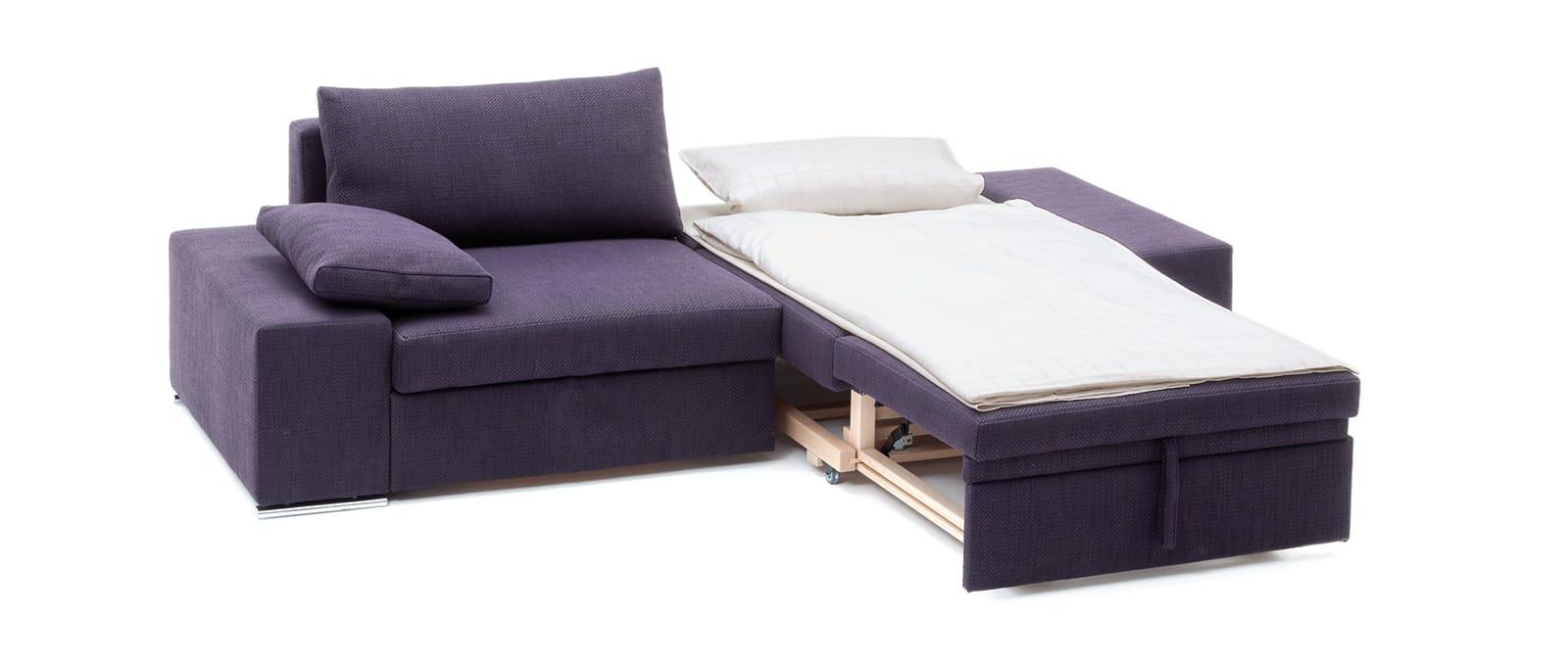 CLUB Schlafsofa von Franz Fertig in Lila - Liegefläche in ca. 80x200 oder 90x200 cm erhältlich. Wunderbares Gästebett. Sofa mit Bettfunktion.