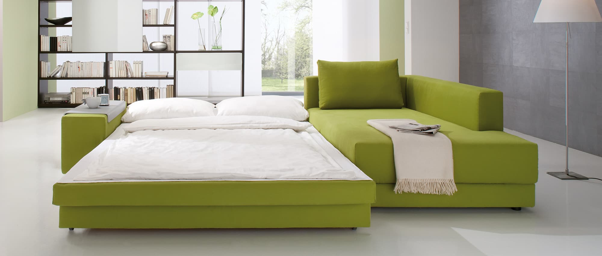 CONFETTO Eckschlafsofa mit Bettkasten von Franz Fertig - Liegefläche in ca. 130x230 und ca. 150x230 cm wählbar. Gästebett mit Stauraum.