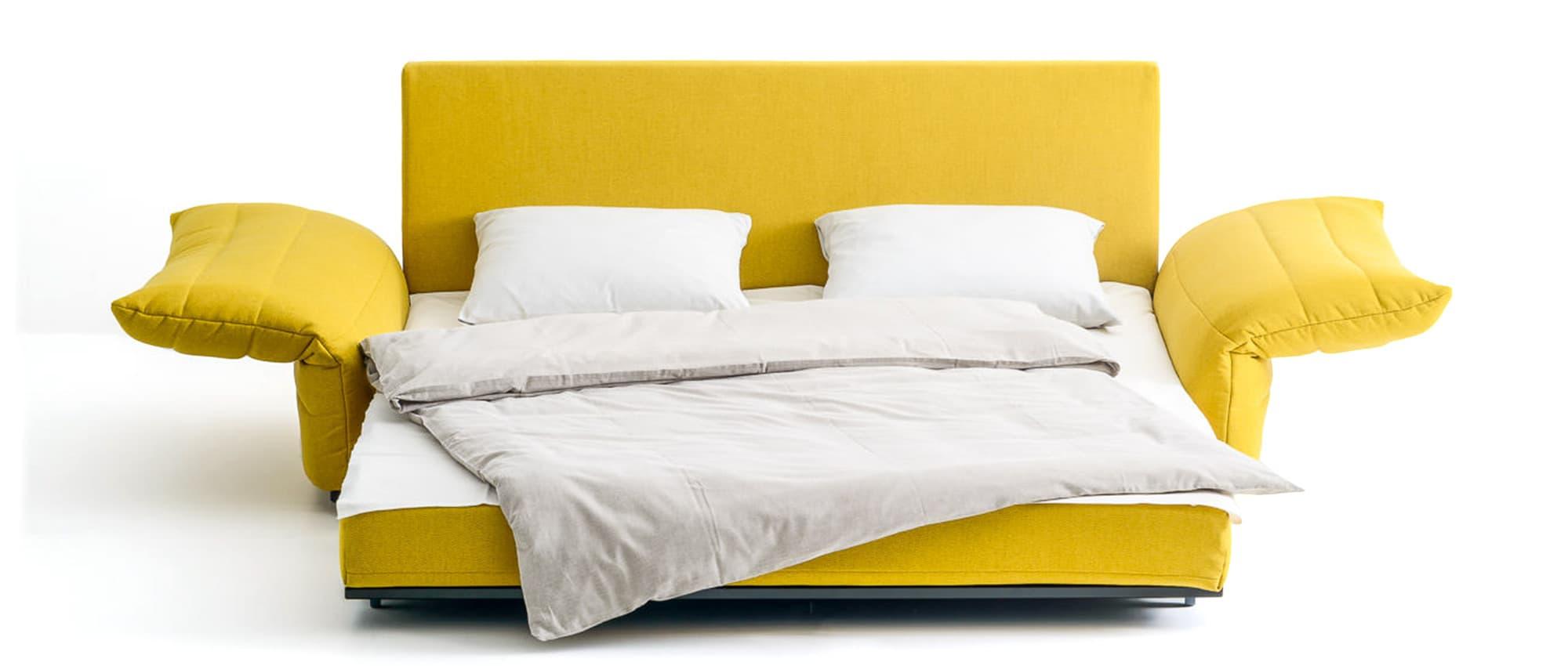 ZERO Schlafsofa von Franz Fertig - Liegefläche ca. 150x200 cm. Schlafsofa in gelb. 150x200 cm große Liegefläche. Sofa mit Schlaffunktion.